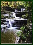 Several cascading waterfalls in Buttermilk Falls State park, Ithaca, NY.