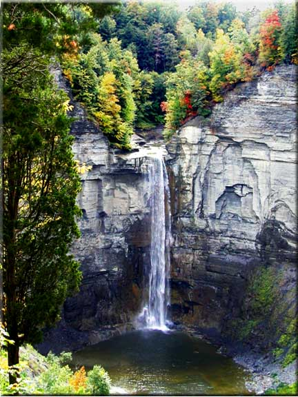 Bright sparks of color show from the top of Taughannock Falls.
