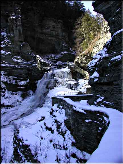 A coating of sunlit snow emphasizes the lovely angles and steep cliffs in Robert Treman State Park.