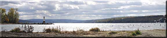 Panorama photograph of the lighthouse and Cayuga Lake at Myers Point.